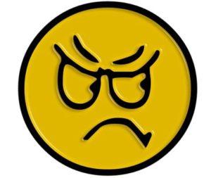смайлик с недобрым выражением лица. иллюстрация