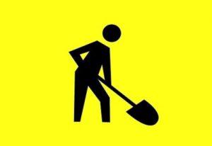 силуэт человека с лопатой. иллюстрация