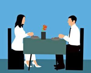 Мужчина и женщина за столом. иллюстрация