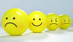 """Четыре смайла с выражением различных эмоций на """"лице"""". иллюстрация"""